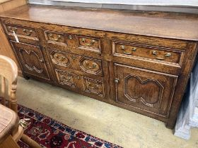 An early 18th century oak low dresser, with a geometric block mounted front, length 184cm, depth