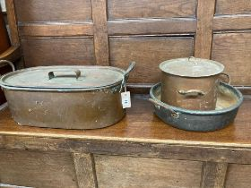 Two Victorian copper pans and a preserve pan, largest 59cm wide