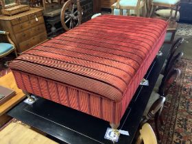 A large Victorian style rectangular upholstered footstool on six turned feet, length 156cm, depth