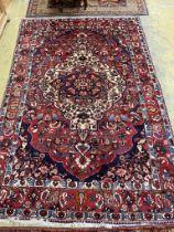 A Heriz style red ground carpet, 310 x 210cm