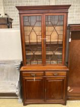 A Victorian mahogany bookcase cupboard, length 106cm, depth 47cm, height 222cm