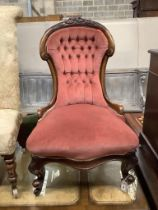 A Victorian mahogany framed buttoned back nursing chair