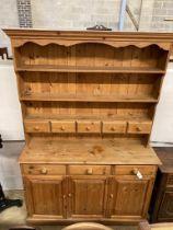 A Victorian style pine dresser, length 140cm, depth 44cm, height 208cm