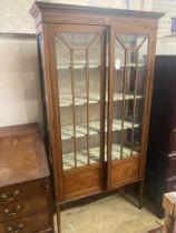 An Edwardian inlaid mahogany display cabinet, width 100cm, depth 33cm, height 194cm