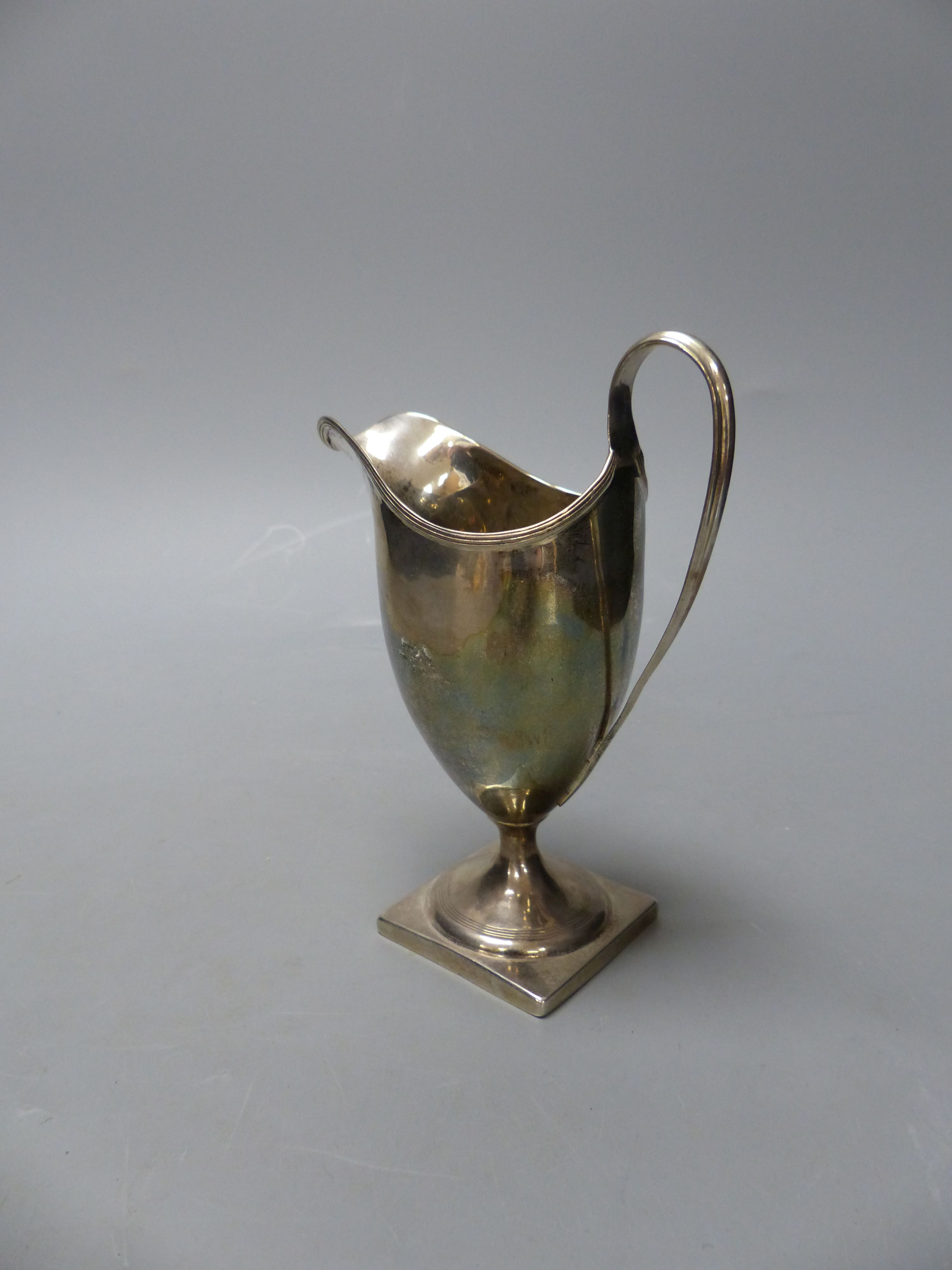 A George III silver helmet shaped cream jug, I.B, London, 1800, 14.9cm,114 grams. - Image 4 of 4