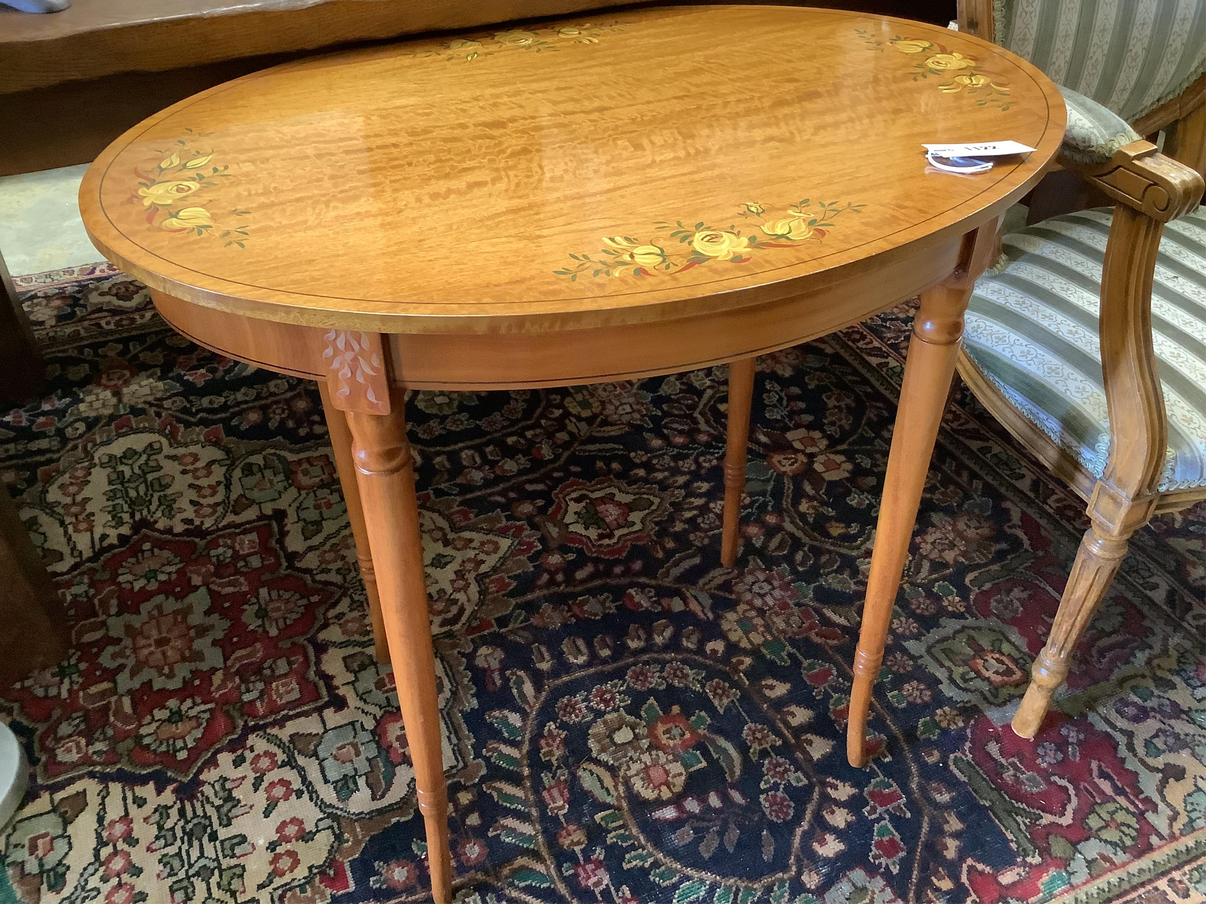 A painted oval satinwood occasional table, width 74cm, depth 51cm, height 70cm