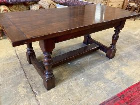 A 17th century style oak refectory tablehaving three-plank top on turned bulbous supports with H