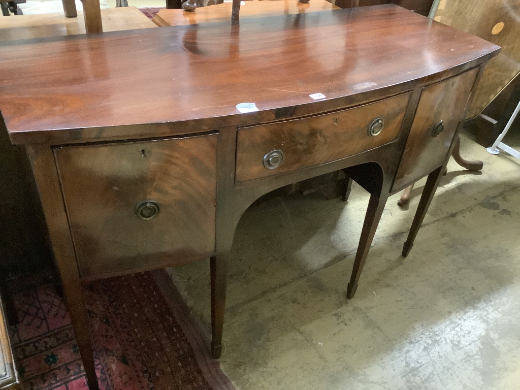 A late 19th century Sheraton style mahogany bowfront sideboard, fitted three drawers, length 140cm,