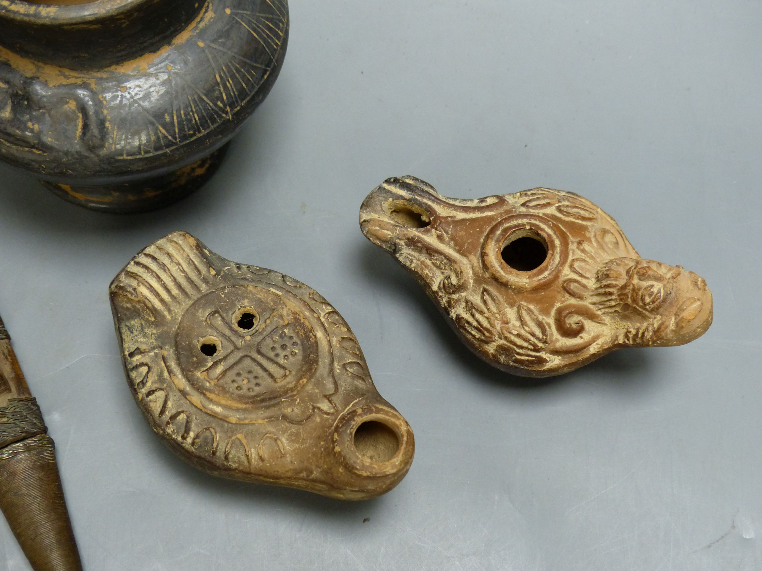 A group of antiquities, three oil lamps, a vase and a figure, etc. - Image 4 of 5