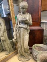 A reconstituted stone garden ornament of a lady with ewer, height 100cm
