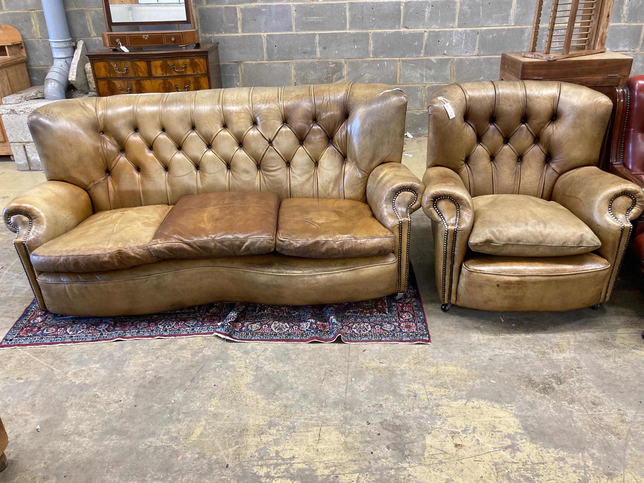 A three-seater Chesterfield leather settee, length 180cm, depth 100cm, height 84cm and a matching