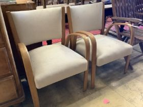 A pair of mid century elbow chairs
