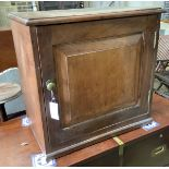 A Victorian mahogany cupboard, enclosed by a panelled door, width 60cm, depth 39cm, height 57cm