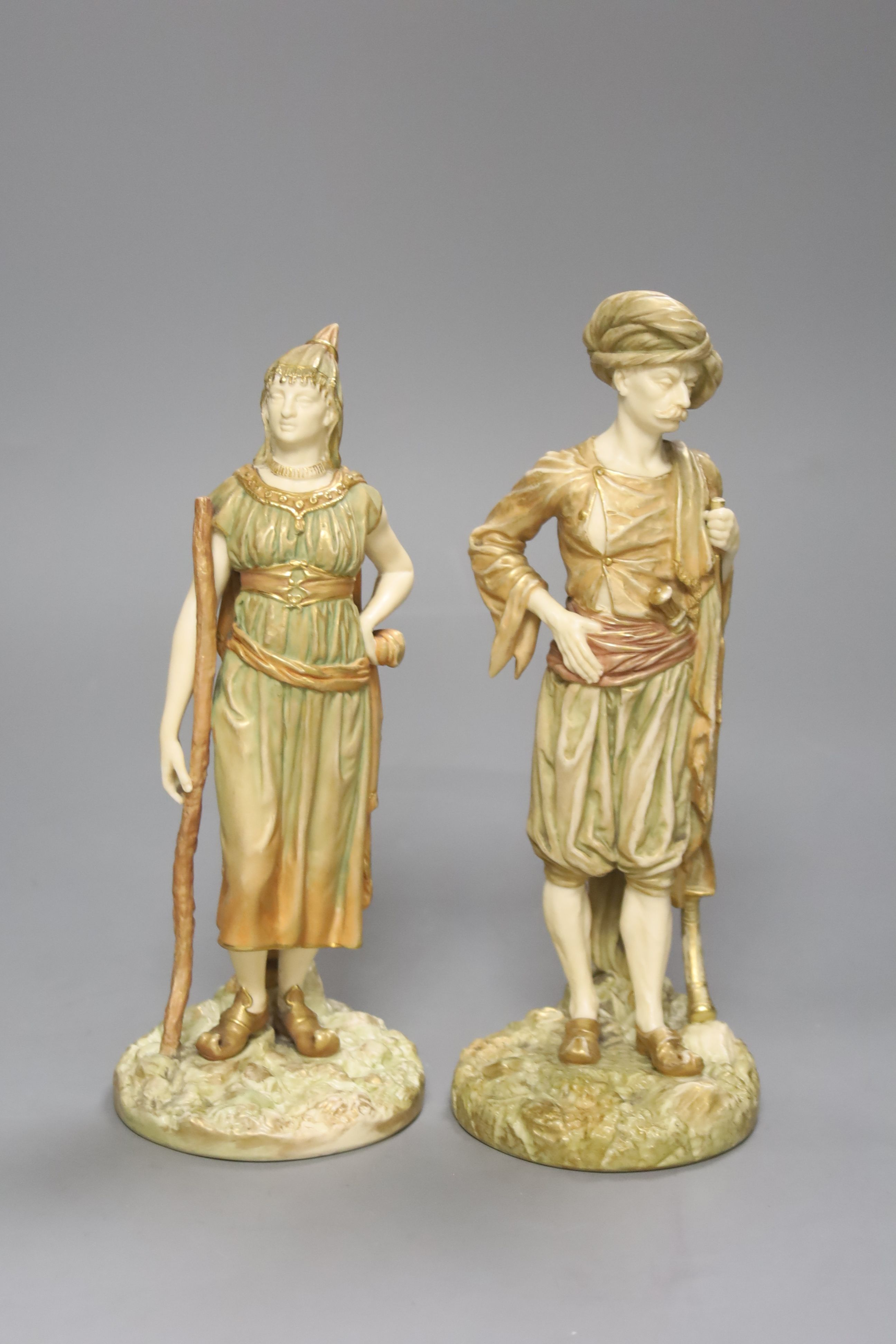 A pair of Royal Worcester blush figures of Bringaree Indians, 1893, height 23cm