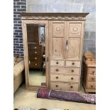 An Edwardian pine compactum wardrobe retailed by Maple & Co., length 113cm, depth 60cm, height