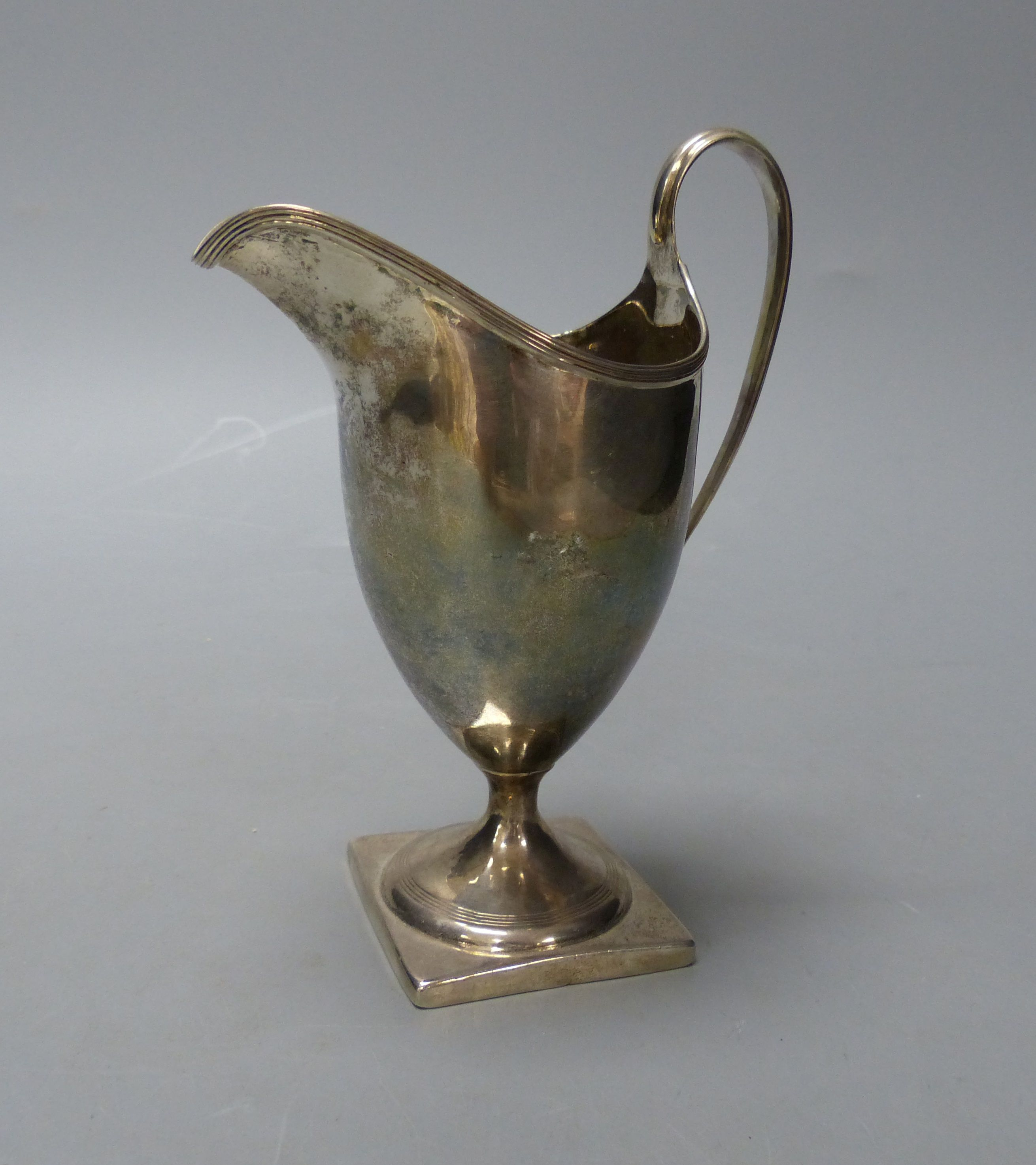 A George III silver helmet shaped cream jug, I.B, London, 1800, 14.9cm,114 grams.
