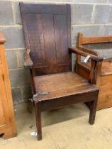 An early 18th century oak elbow chair, width 68cm, depth 63cm, height 112cm