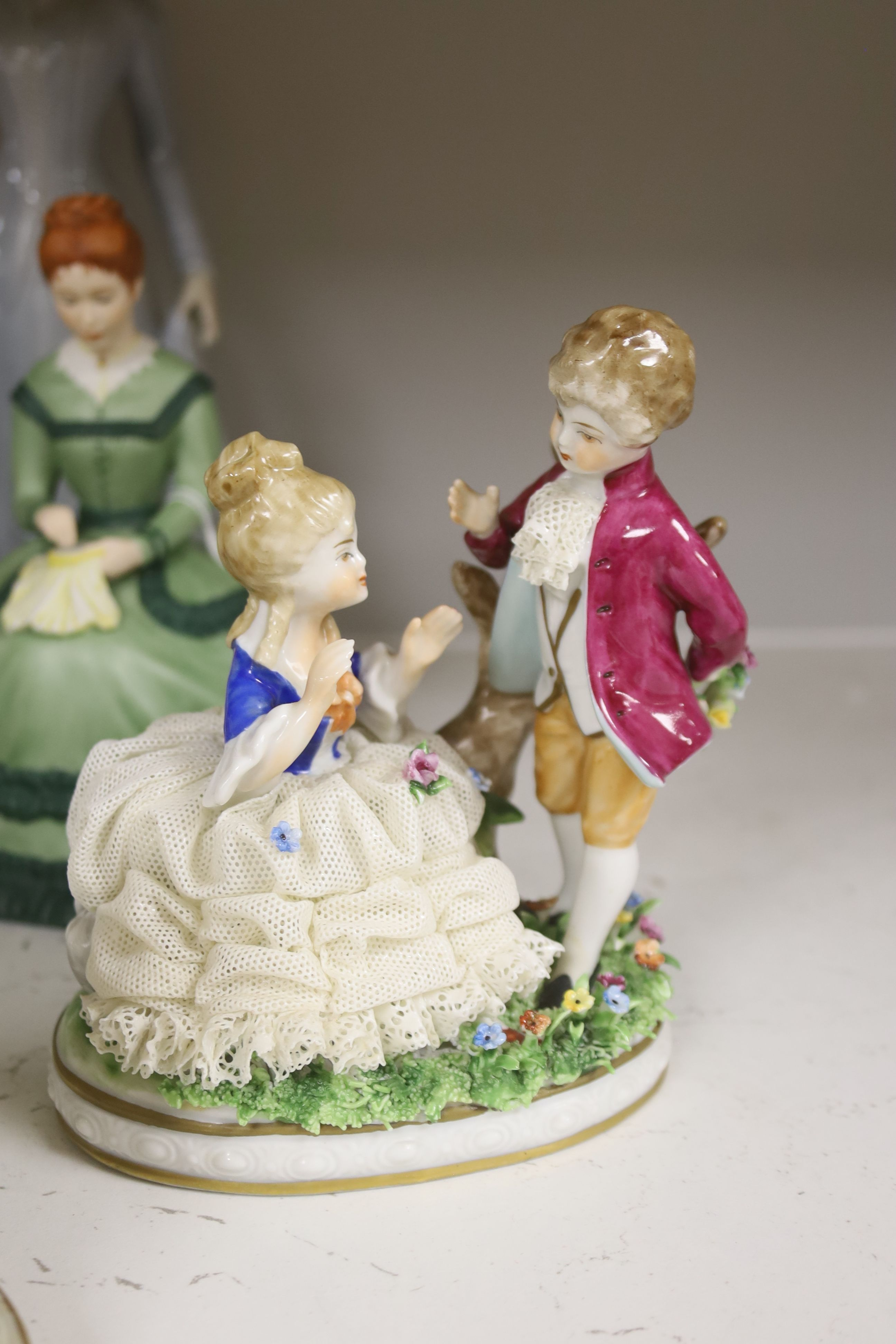 A German porcelain group of two children by a tree stump, on rocky base, two 'crinoline' figures - Image 3 of 6