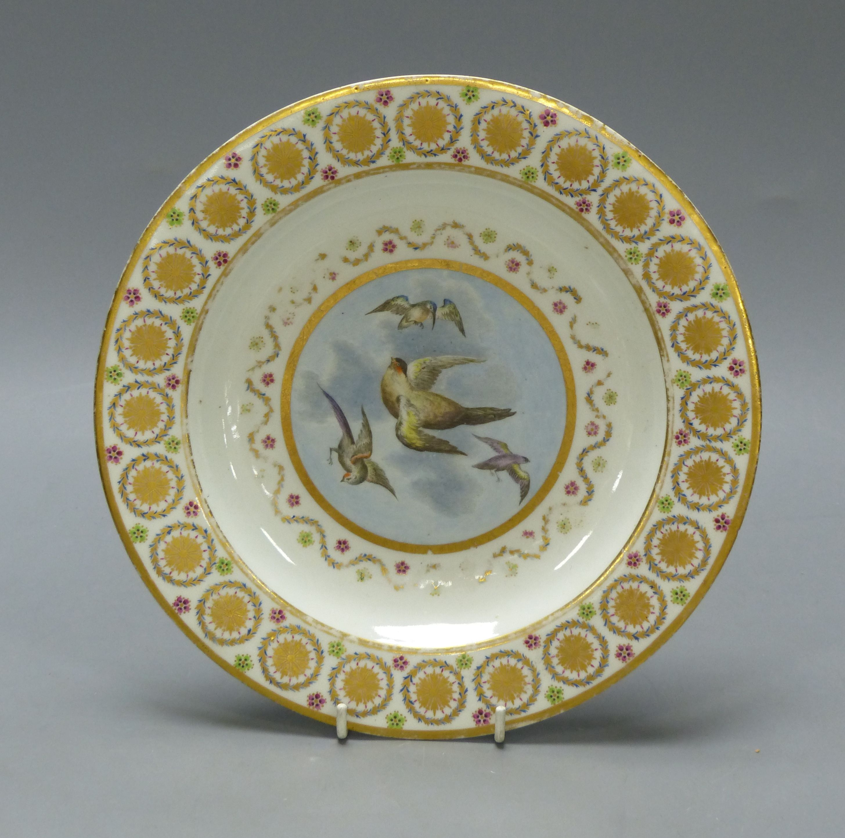 A Crown Derby plate painted with birds, c.1810, diameter 24.5cm