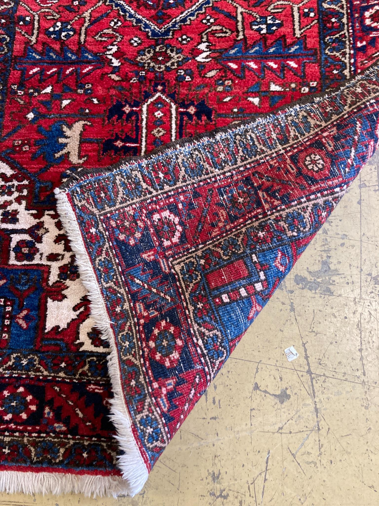 A North West Persian red ground hall carpet, 440 x 115cm - Image 2 of 2