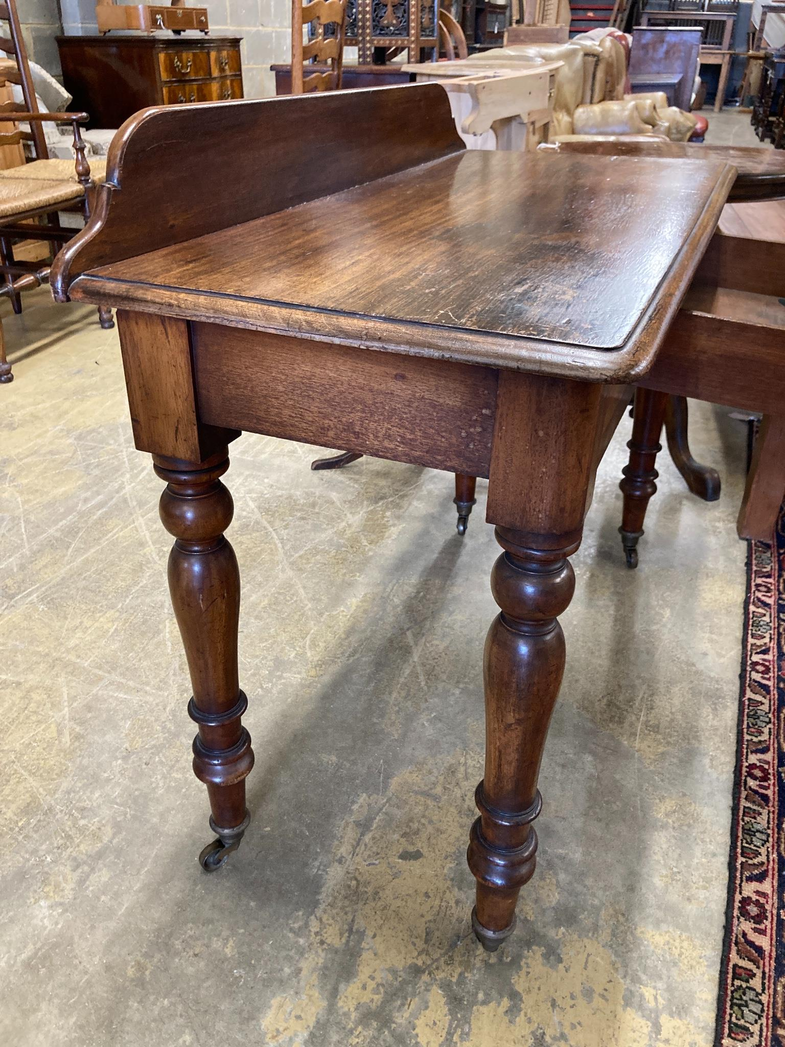 A Victorian mahogany writing tablefitted two small drawers on turned tapered legs, length 106cm, - Image 4 of 6