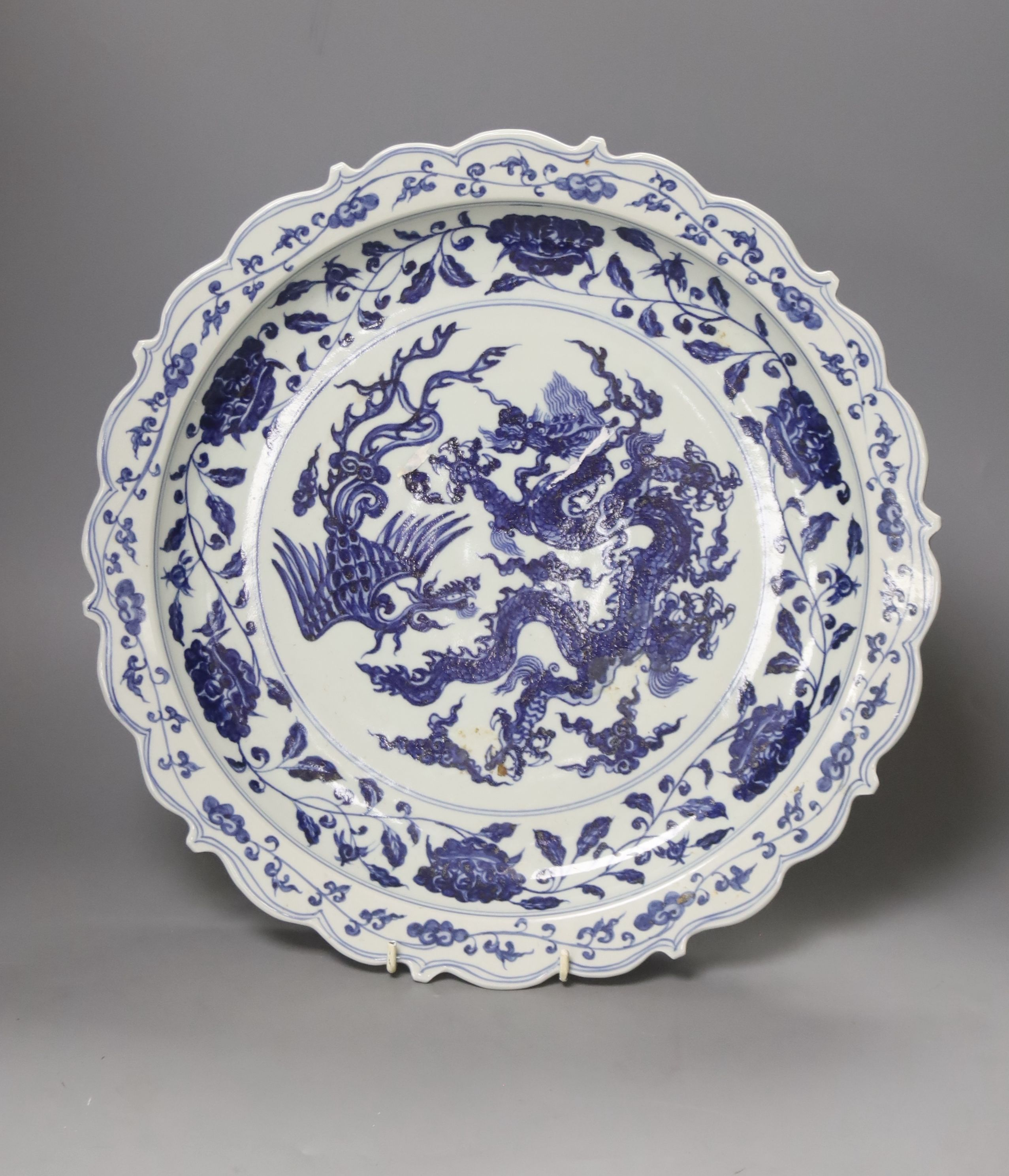 A Chinese blue and white Ming style dragon and phoenix dish, diameter 40cm