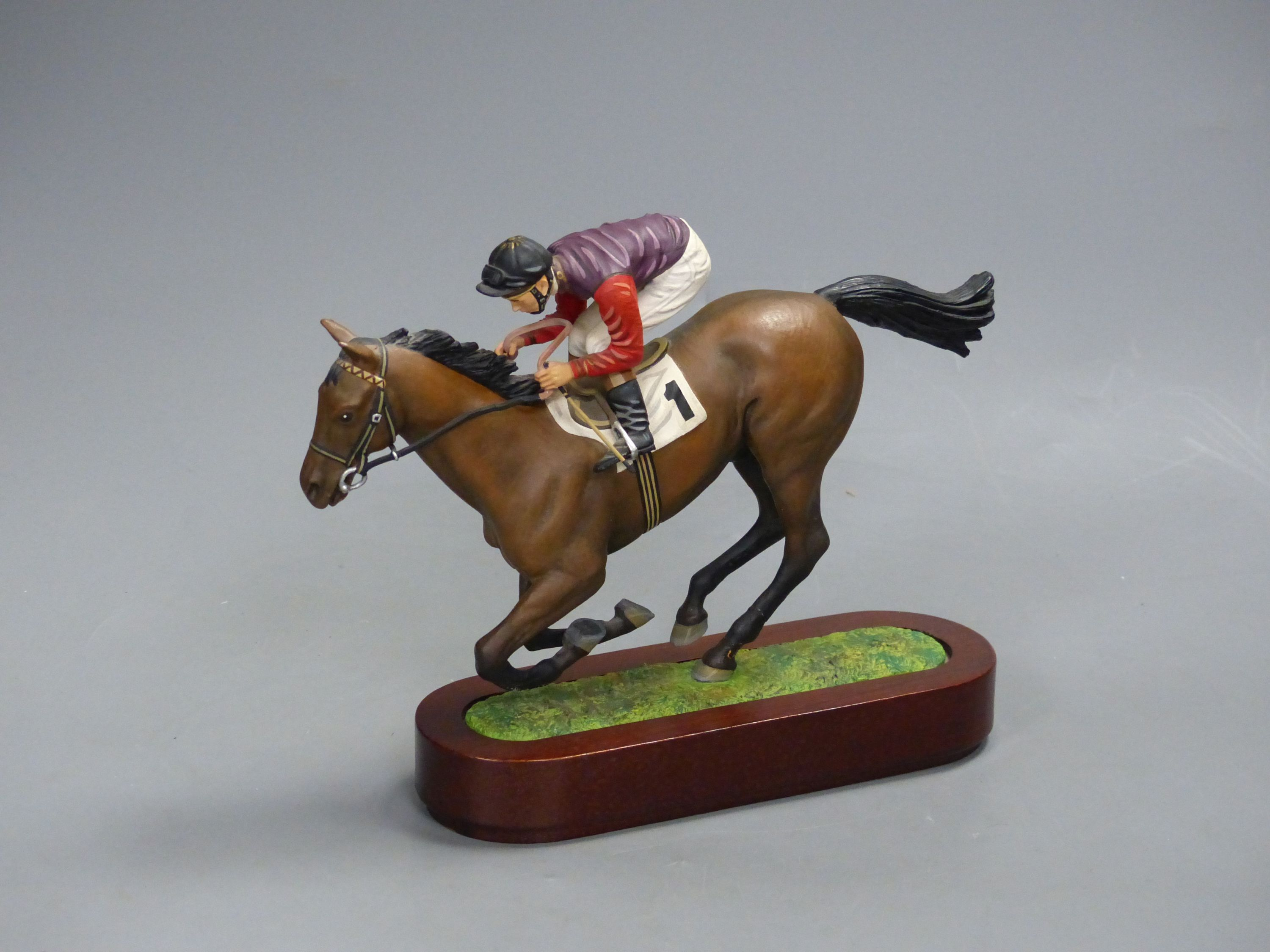 A Cameron Sculptures cold-painted bronze model of a racehorse with jockey up, height 16.5cm