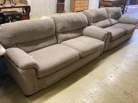 Two matching contemporary four-seater settees with grey/brown upholstery, length 200cm, depth