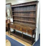 A mid 18th century oak potboard dresser, width 181cm, depth 45cm, height 210cm