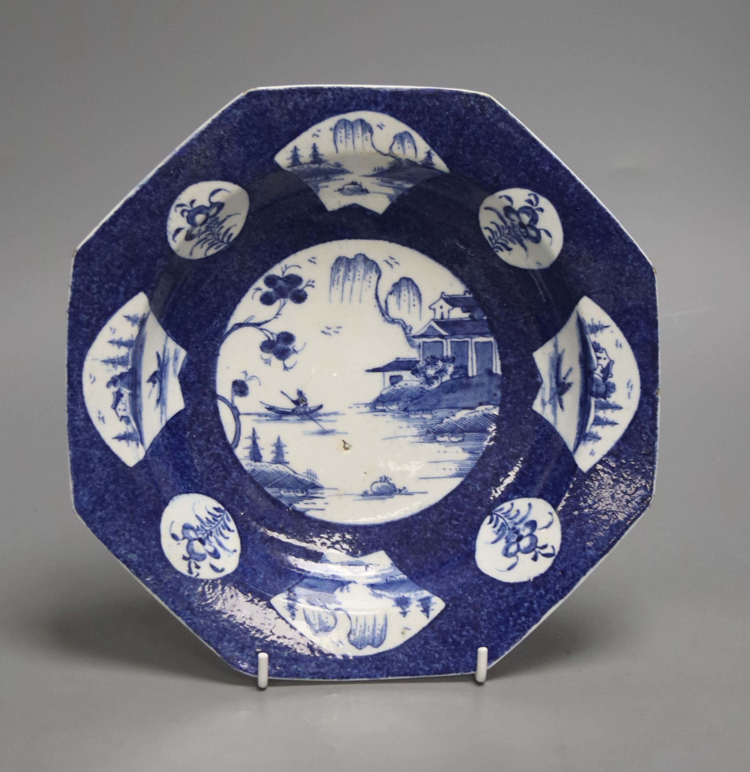 A Bow octagonal plate, painted with landscapes on a blue ground, c.1757, six character mark, 22cm