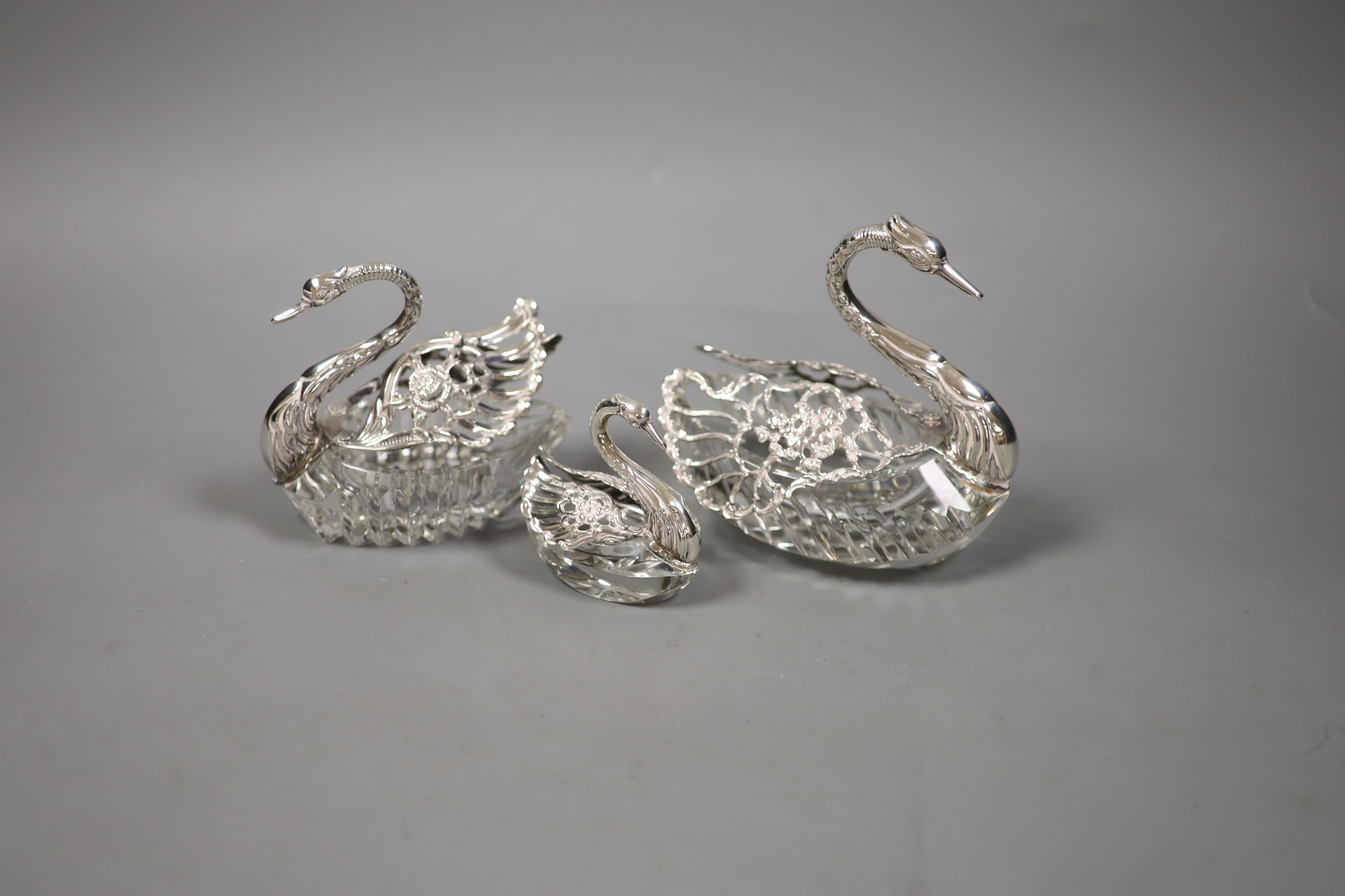 A set of three graduated silver-mounted cut glass 'swan' bon bon dishes,