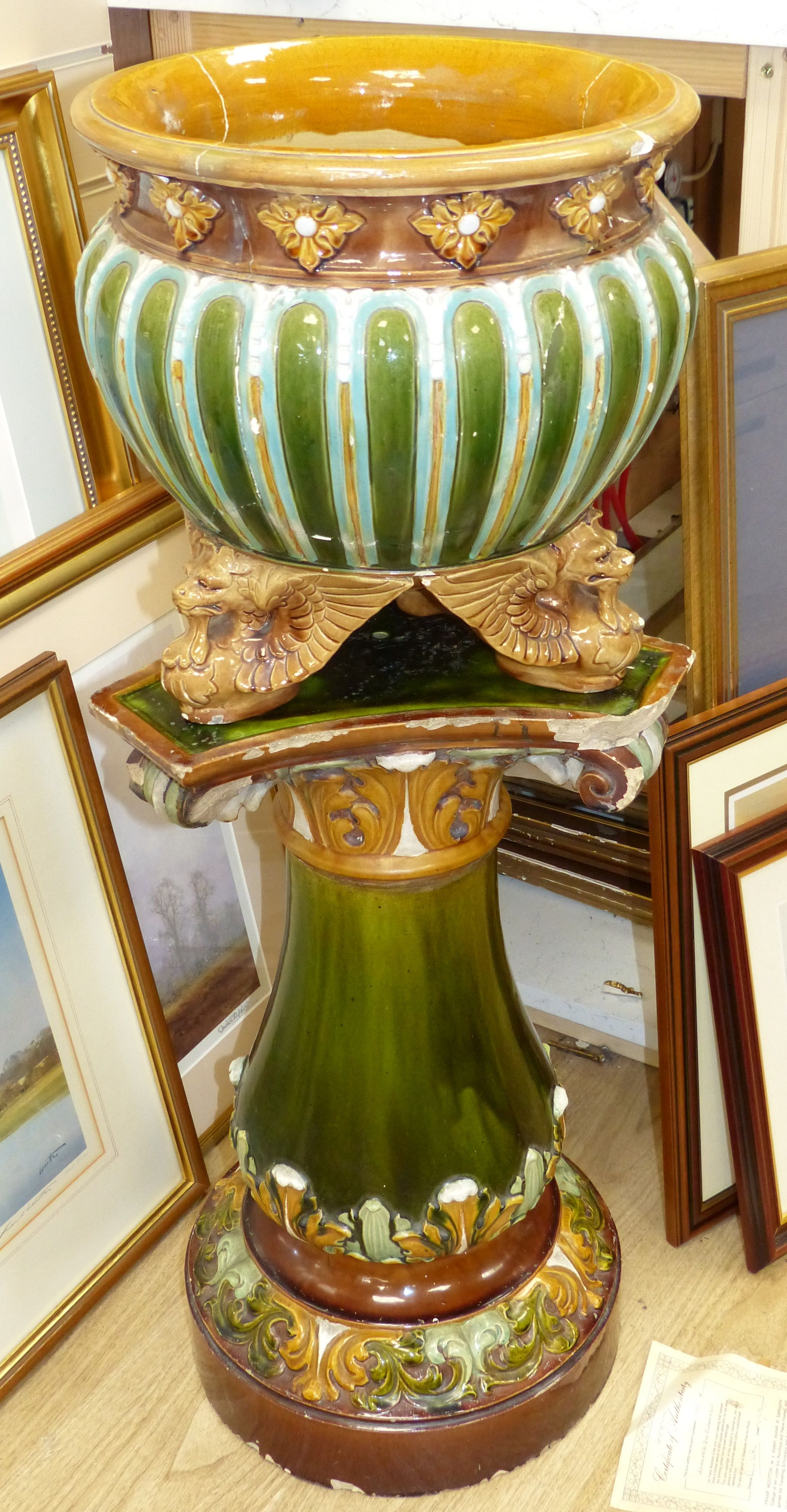 A Doulton Lambeth jardiniere on stand, overall height 92cm (a.f.), the stand apparently unmarked
