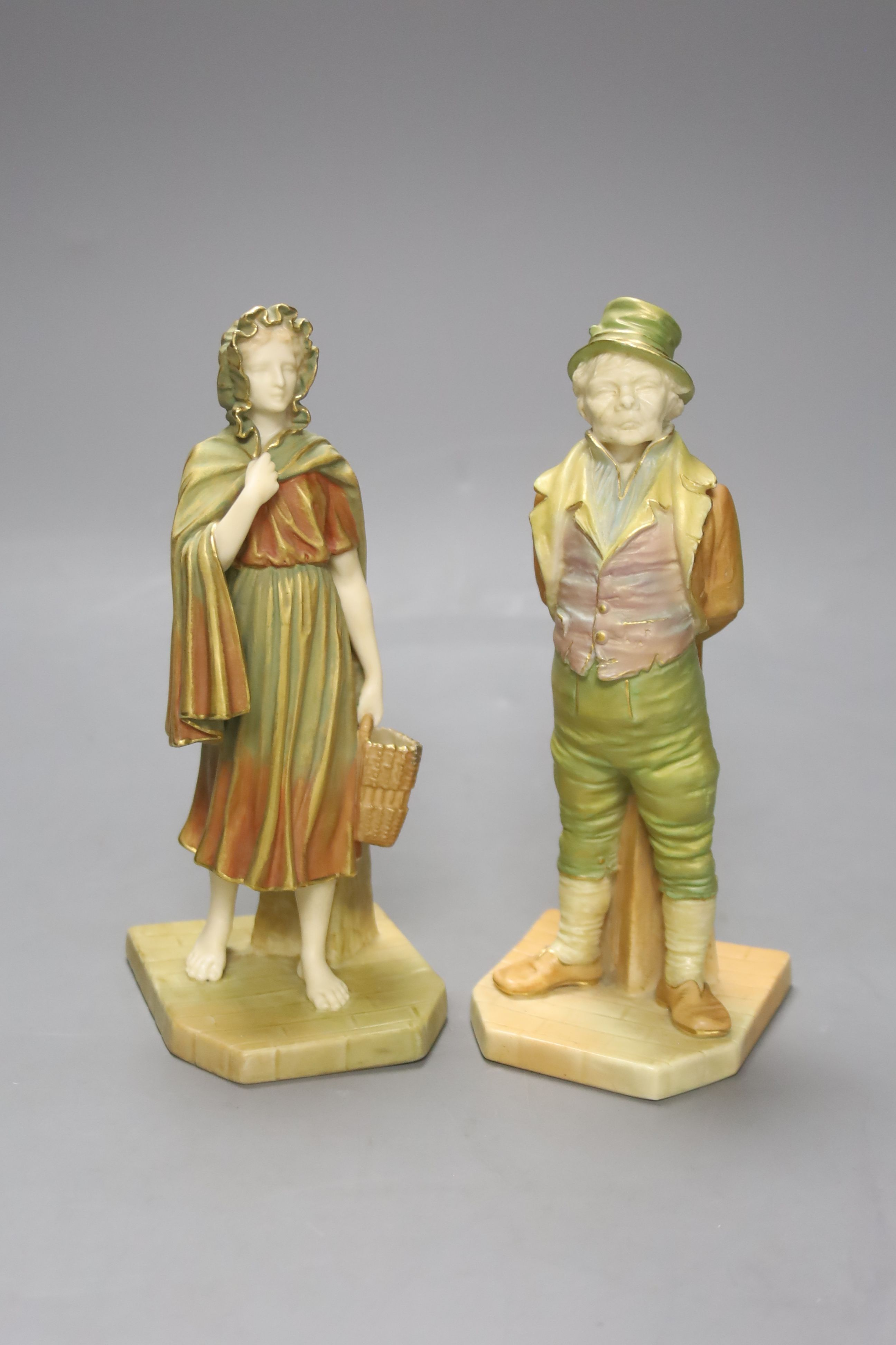 A pair of Royal Worcester blush figures of an Irishman and Irish girl, height 17cm