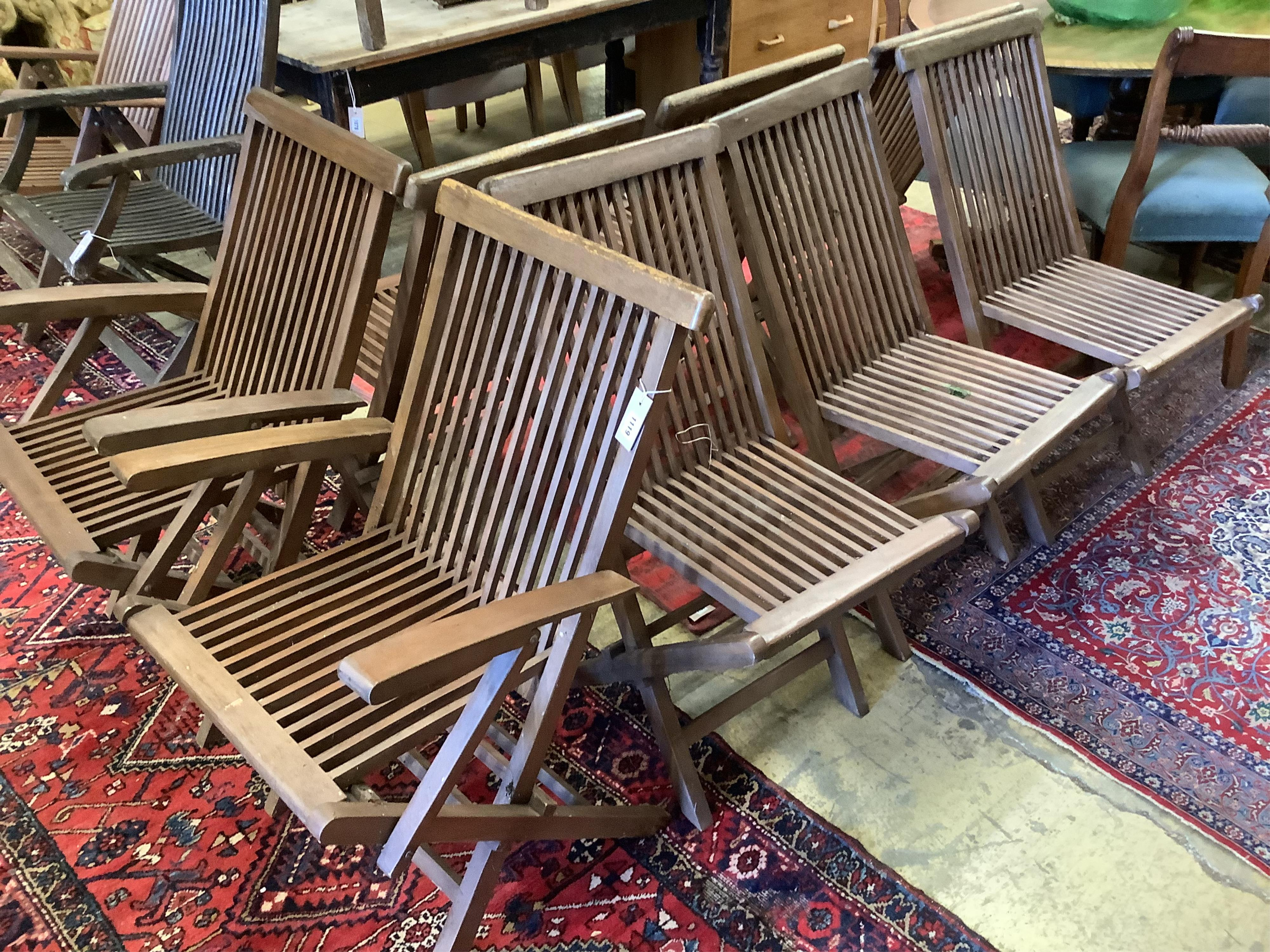 A set of eight teak folding garden chairs (two with arms)