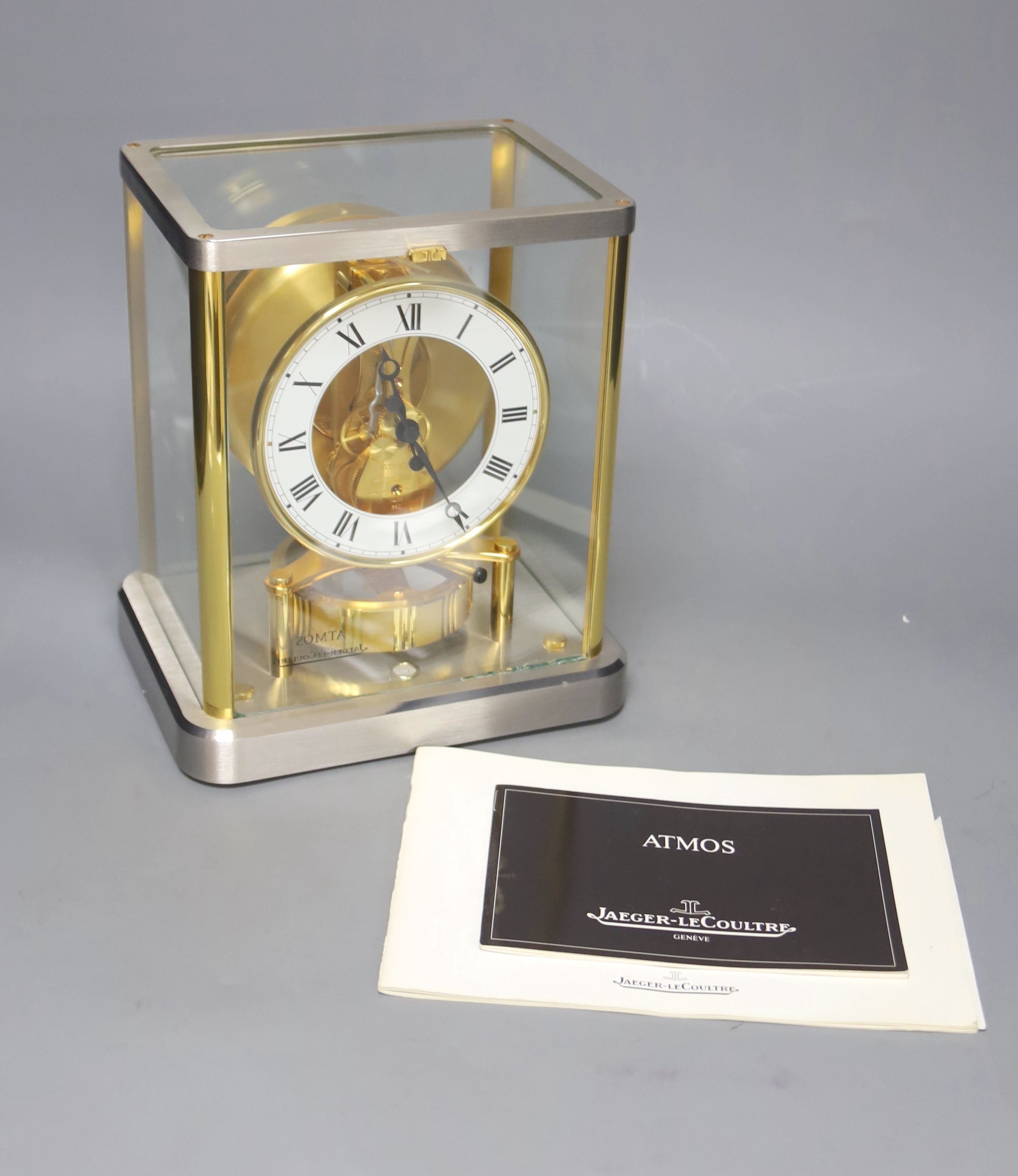A Jaeger le Coultre Atmos mantel clock, in silvered and gilt metal glazed panelled case, height