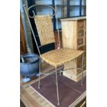 A set of contemporary wrought iron and rattan dining chairs