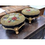 A pair of Victorian floral tapestry circular carved giltwood footstools, length 36cm, height 20cm