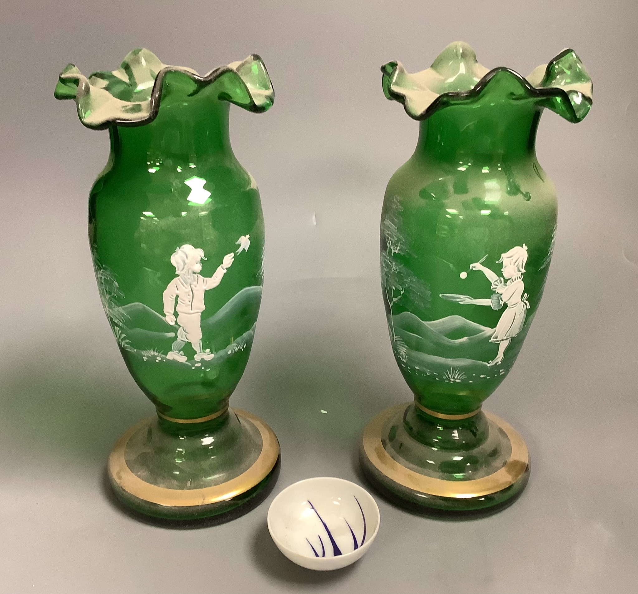 A pair of Mary Gregory style green glass vases and a soy sauce dish