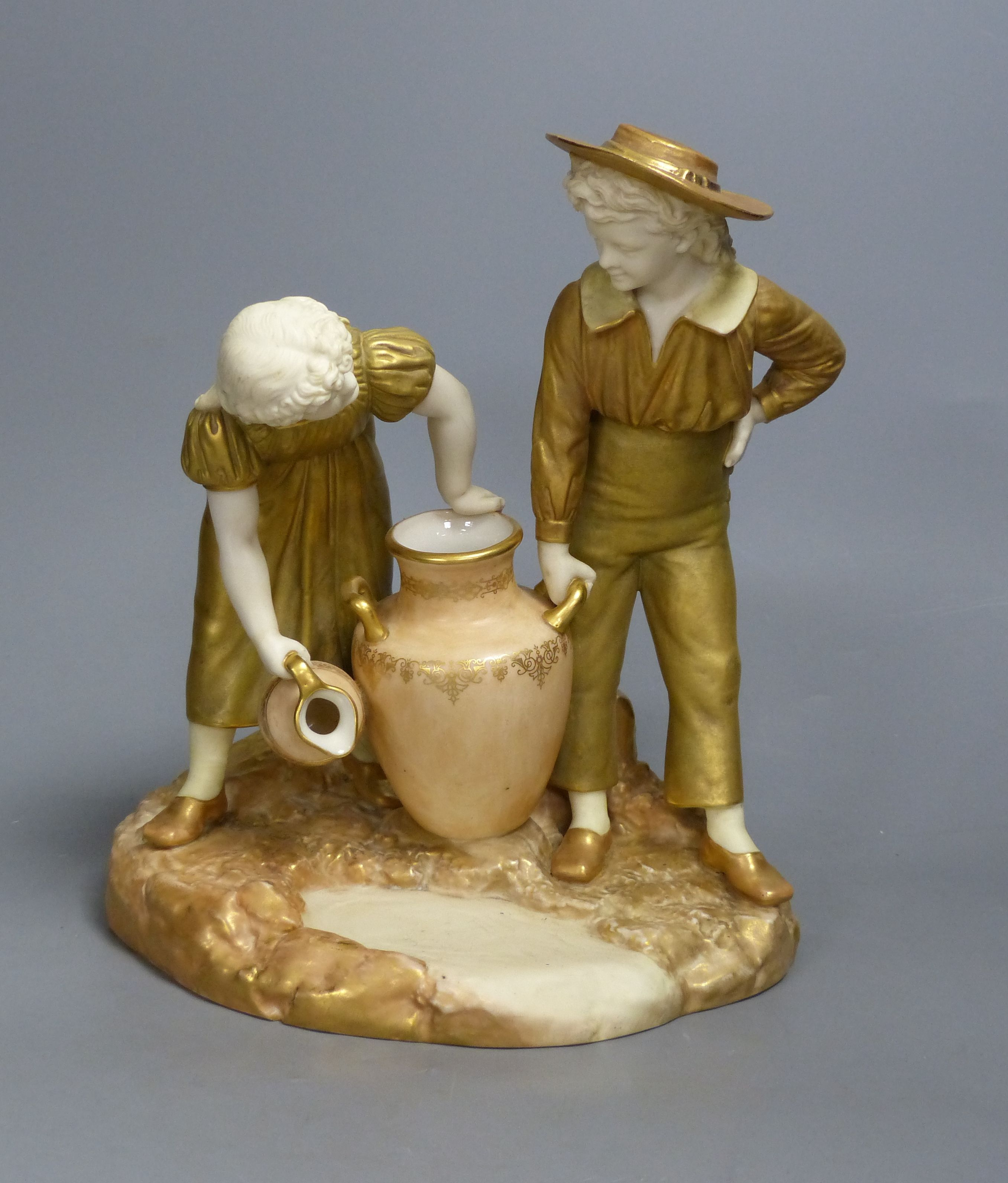 A Royal Worcester group of a boy and a girl, date code for 1917, height 24cm