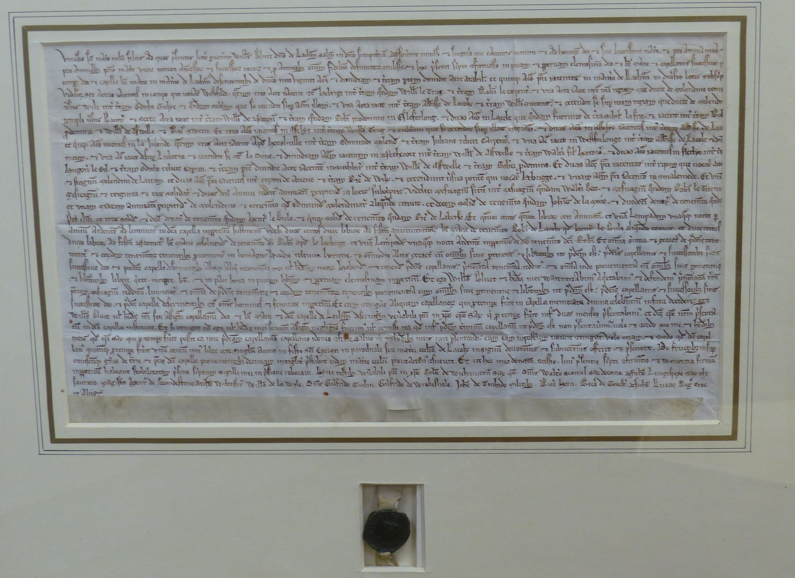 Two early deeds, framed,comprising 'William Bluet, Lord of Lachan, witnessed by Robert Witchampton,