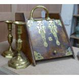 A Victorian brass bound walnut coal scuttle and a pair of brass candlesticks
