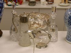 Two cut glass decanters (one silver-mounted), two silver Whisky and Gin labels, an 'Etains du