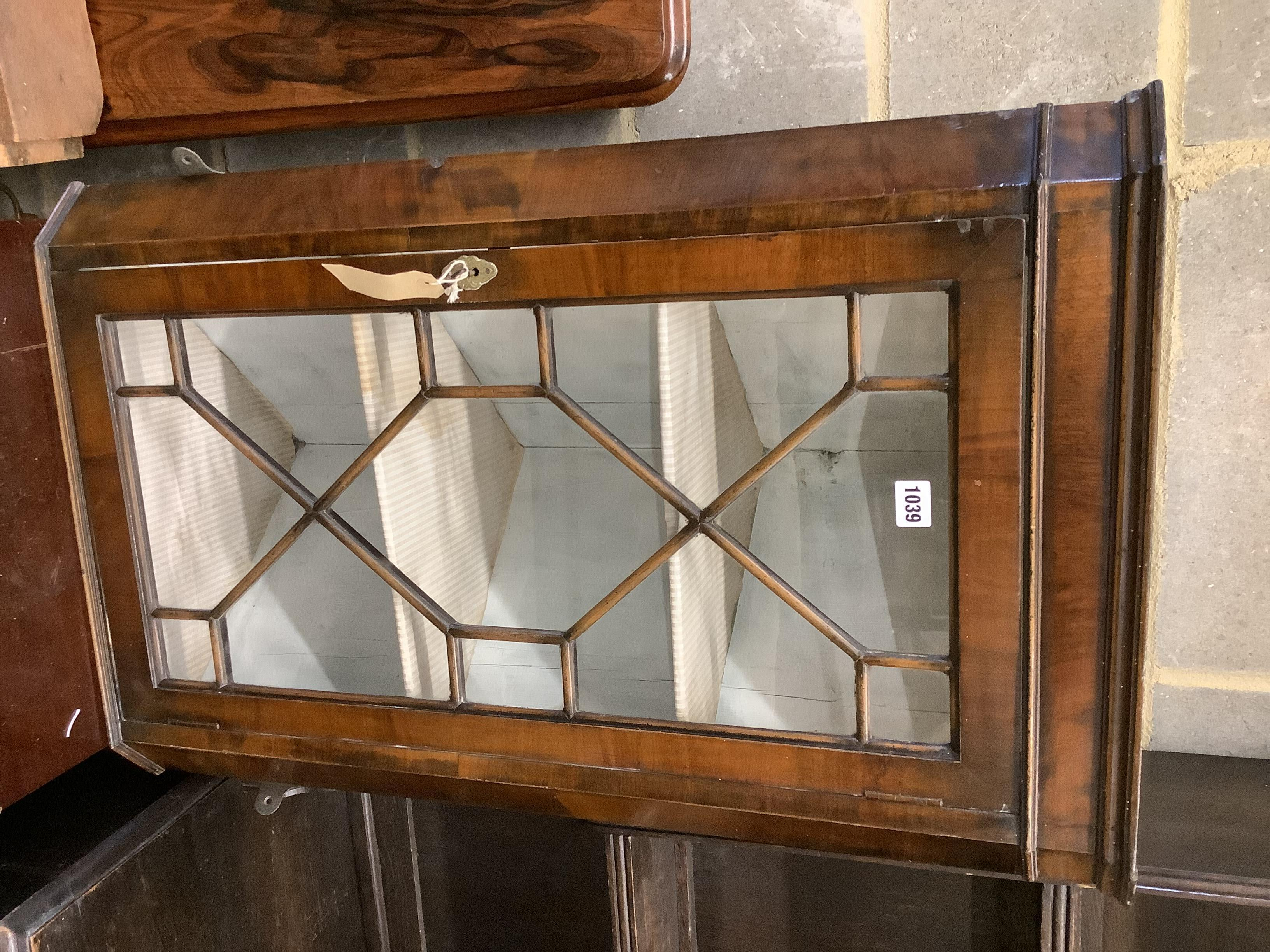 A Queen Anne style hanging corner cabinet, width 55cm, depth 32cm, height 83cm