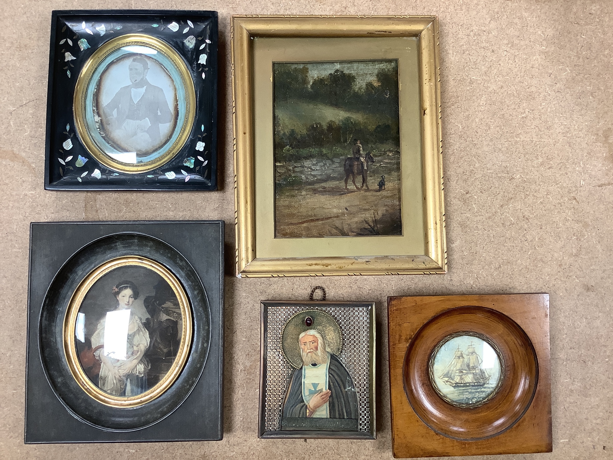A 19th century Daguerreotype portrait of a gentleman, together with a small Russian painted icon, a