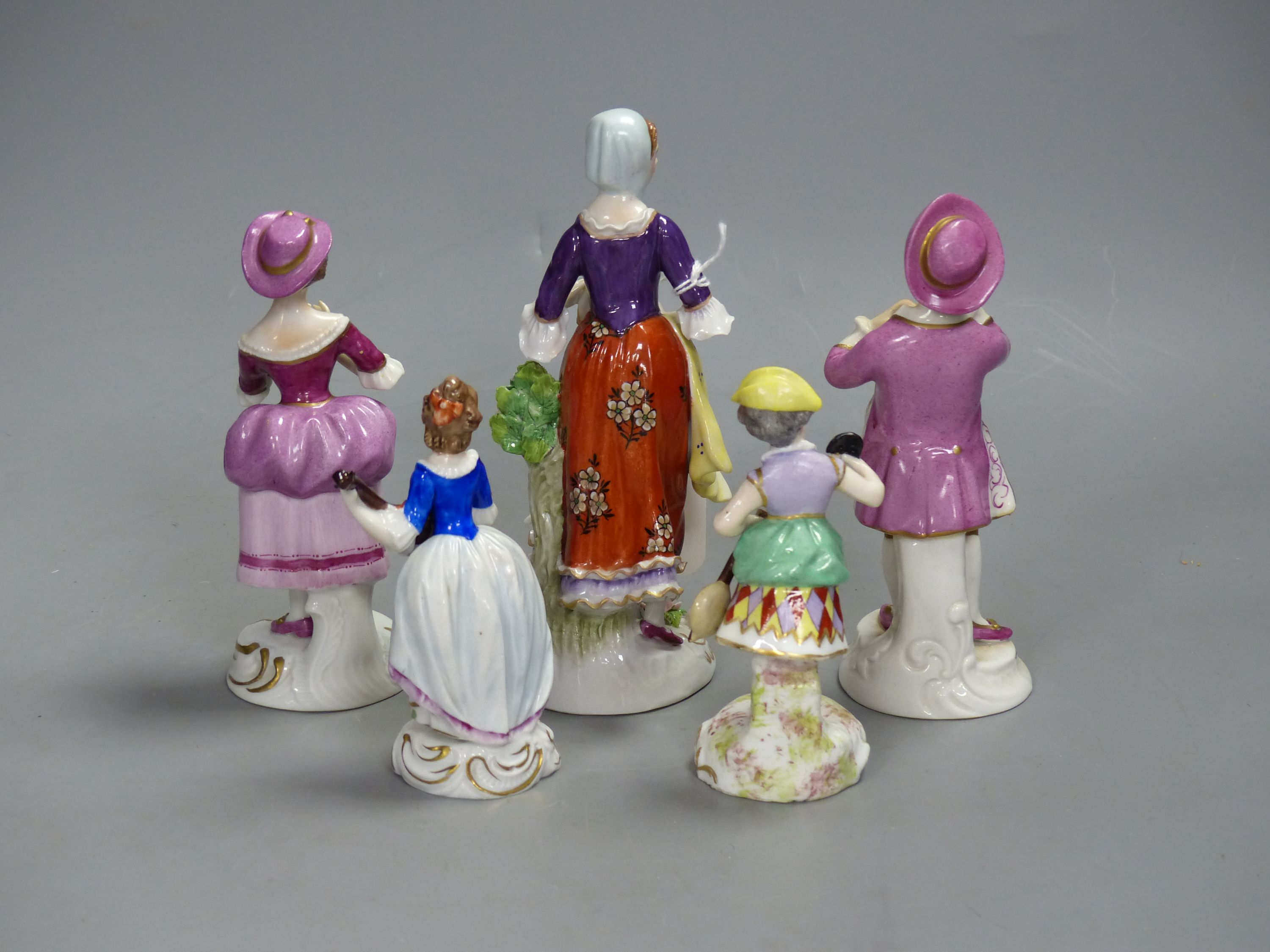 A German porcelain figure of a masked harlequin with stringed instrument and four other Continental - Image 2 of 3