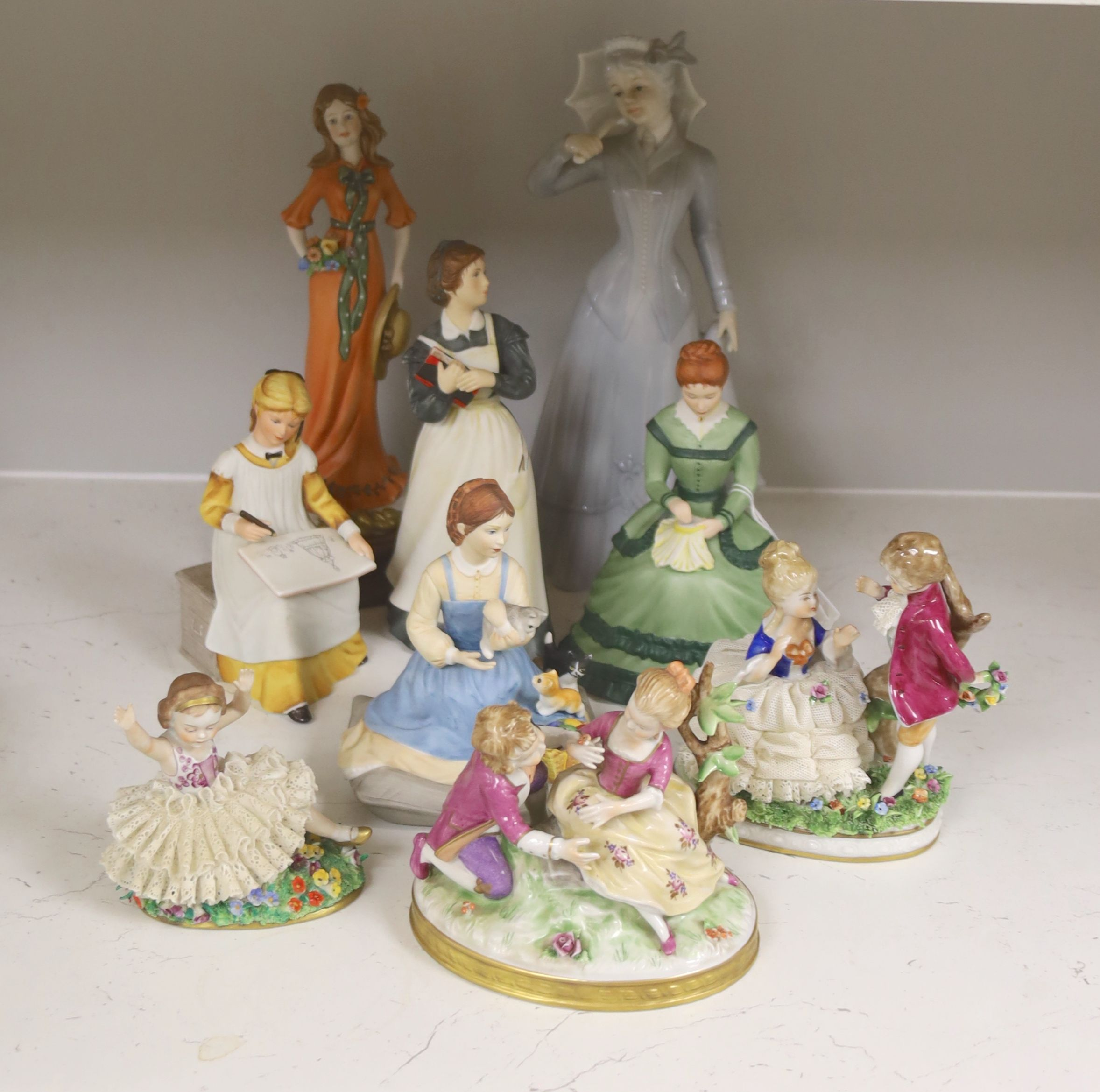 A German porcelain group of two children by a tree stump, on rocky base, two 'crinoline' figures