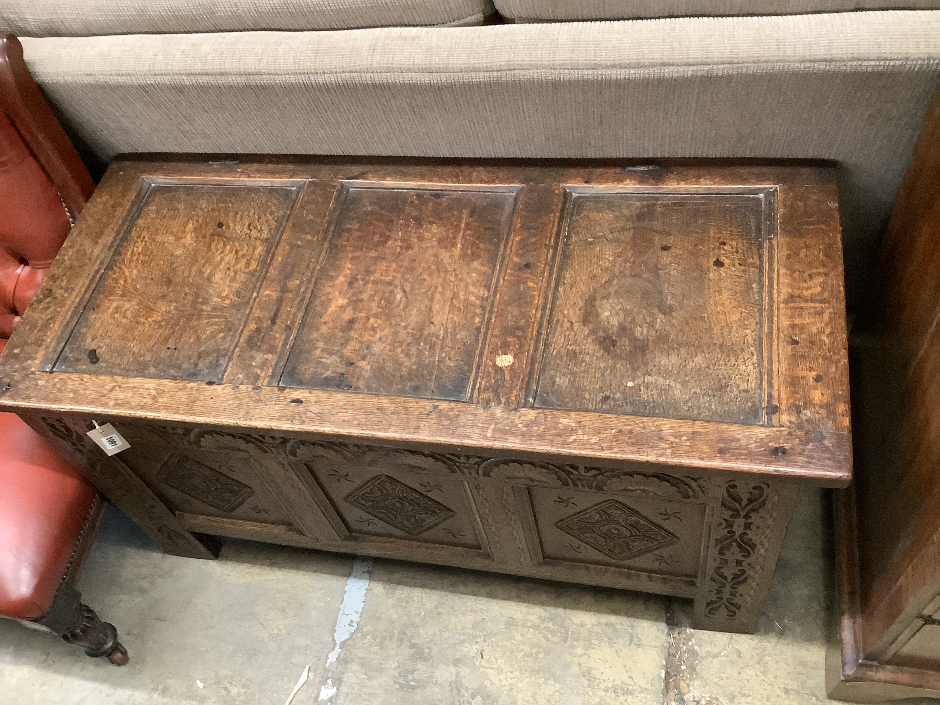 A 17th / 18th century panelled carved oak coffer, length 122cm, depth 53cm, height 61cm - Image 2 of 3