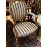 A Louis XVI design upholstered open armchair
