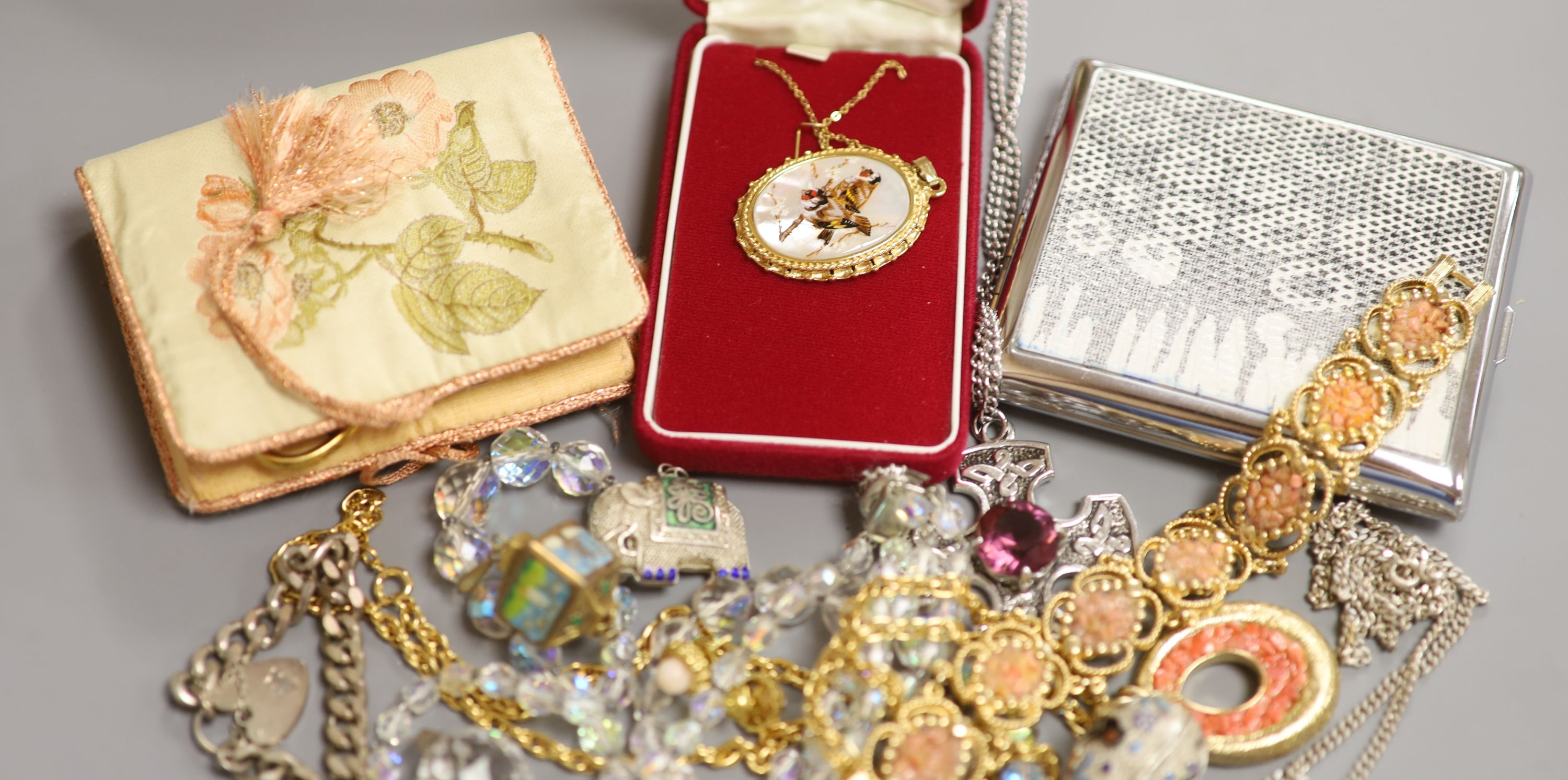 Mixed jewellery including silver bracelet, costume jewellery and a cigarette case.