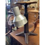 A vintage cast iron Singer stool and an industrial style floor lamp (2)